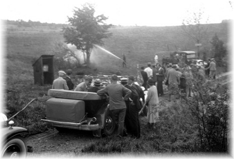 Forest rangers pictured with Governor Franklin D. Roosevelt demonstrating the pumping capabilities of a newly acquired vehicle.